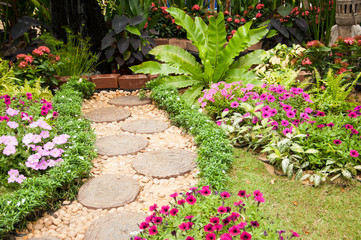 Stone Paved Garden Path with a Lawn and Flowerbed