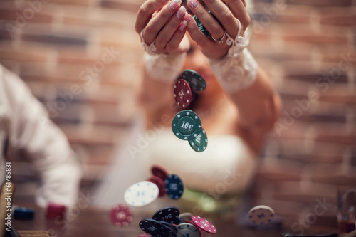 wedding. Bride is holding the chips in a poker game