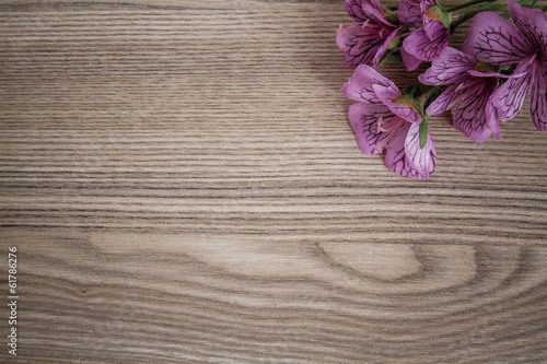 Articial Flowers on Wooden Desk