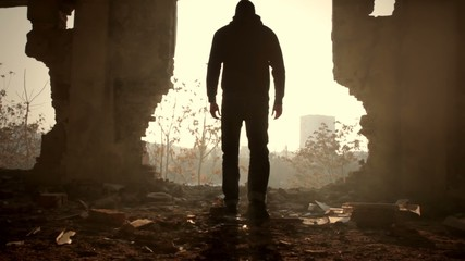 Man Walking Toward Hope Sun Light Out of Darkness Destruction
