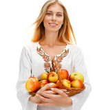 Cute woman with ripe apples