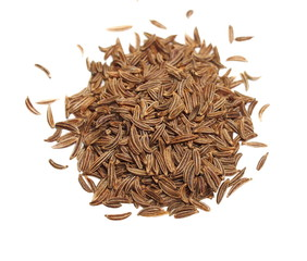 Pile macro caraway isolated on white, spice cumin in grain