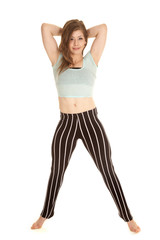 black white striped pants stand arms behind head