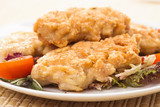 Fresh chicken cutlets with vegetables closeup