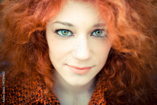 young beautiful red curly hair woman