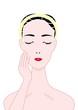 顔の肌に触れる女性