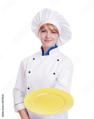 Happy chef with a yellow plate isolated on white