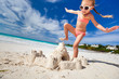canvas print picture - Little girl playing at beach