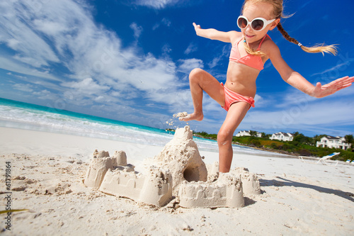 canvas print picture Little girl playing at beach