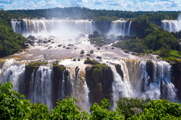 Beautiful Cascade of waterfalls with clouds and jungle. Iguassu
