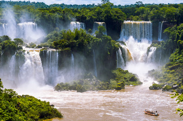 Beautiful cascade of waterfalls. Iguassu falls in Brazil with ri