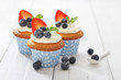 Cupcakes decorated with and fresh berries