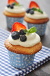 Cupcakes decorated with fresh berries