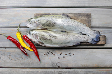 Two rainbow trouts on rustic wooden table