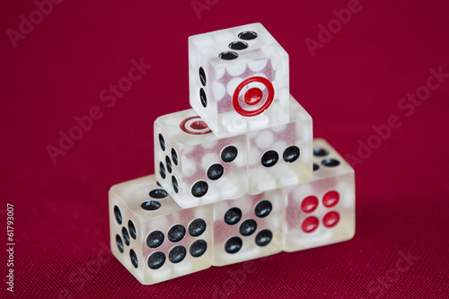 transparent dice on a red felt