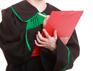 Woman lawyer attorney in polish gown writing on clipboard