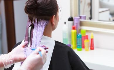 hairdresser applying color client at salon, doing hair dye