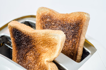 Close up of Toast in a toaster  : Clipping path included.
