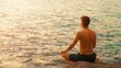 Video 1920x1080 - Young man practicing yoga on the ocean shore