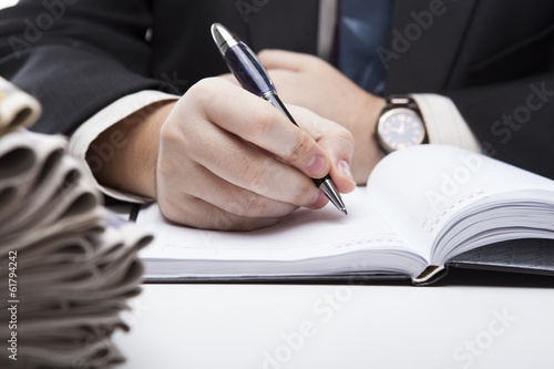 man is preparing for written work