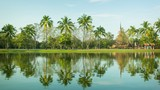 Thailand, Sukhothai - a park with a pond and palm trees