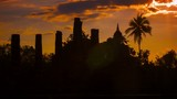 Silhouettes of the ruins of ancient temples at sunset. Thailand,