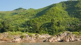 Rocky shore of the Mekong river. View from the boat. Laos