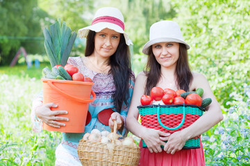 women with vegetables harvest
