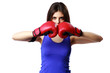 Young fitness woman wearing boxing gloves standing