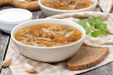 traditional Russian cabbage soup (shchi) with mushrooms