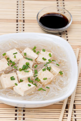 soup with rice noodles and marinated tofu, close-up