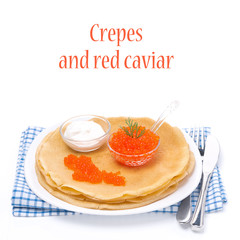 traditional crepes with red caviar and sour cream, isolated