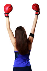 woman wearing boxing gloves standing