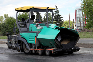 asphalt spreading machine. Road paving construction