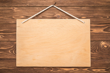 Signboard on wooden background
