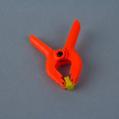 Orange plastic clamp