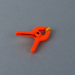 Orange plastic clamp