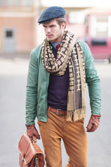 elegant young fashion casual man walking