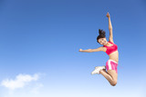 happy young woman jumping in the sky