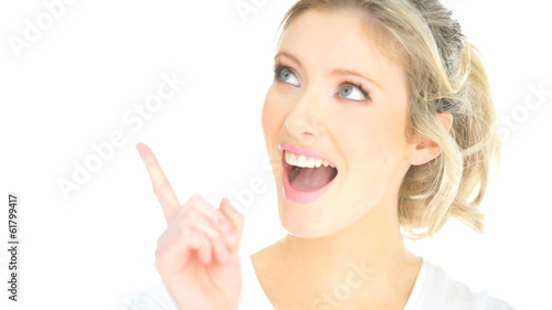 blonde woman pointing up with her fingers