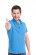 Young happy man with thumbs up sign in casuals