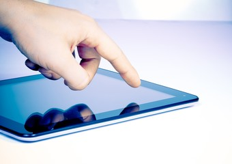 male hand touch tablet pc on table
