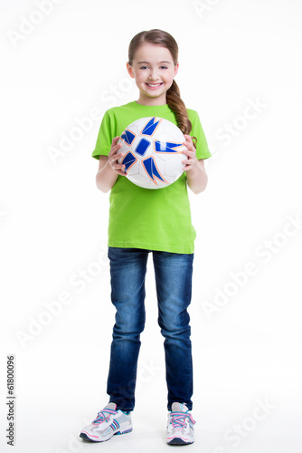 Happy little girl standing with ball.