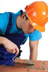 Builder layering bricks