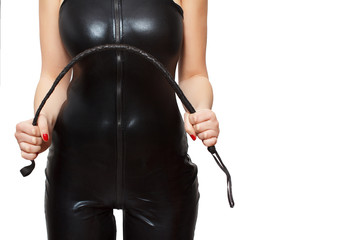 Woman in latex catsuit and whip