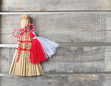Red and white martenitsa on old wooden background
