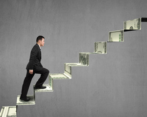 Climbing on money stairs
