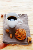 cup of coffee and cookies on a napkin