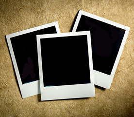 Old Polaroid Film Vintage empty photo cards on paper background
