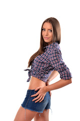 Fashionable young woman posing with hands on butt